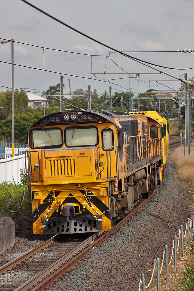 2212 trails a light engine consist at Yeronga by Peter Reading
