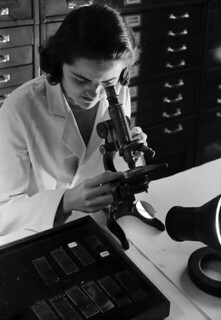 [Woman using microscope, St. Luke's Hospital, U.S. Industrial Alcohol Company] | by SMU Libraries Digital Collections