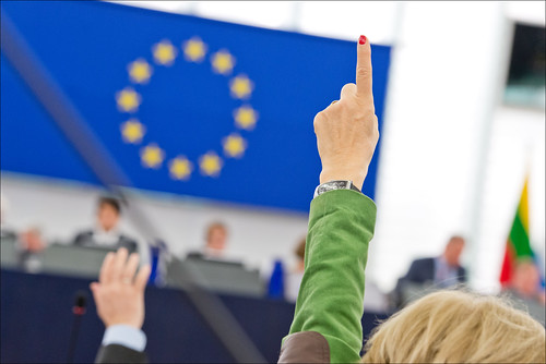 A finger and a hand going up, indicating a positive vote | by European Parliament
