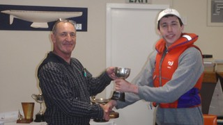 Andrew Coffin receiving the Junior 1st Prize trophy for Match Racing   by PLSC (Panmure Lagoon Sailing Club)