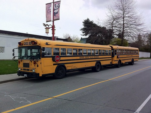 Two school buses in Chinatown | by sillygwailo