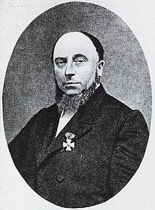 Portret van Julien Wolbers (1819-1889). Gedrukte reproductie (autotypie) van een anonieme foto uit ca. 1879. Coll. Het Utrechts Archief.