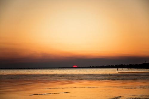 sunset orange sun sunlight lake water canon louisiana warmth sigma orangesky mandeville lakepontchartrain redsun teamcanon 5dmarkiii tyalexanderphotography 70200mmf28exdgapooshsm northshorephotographer