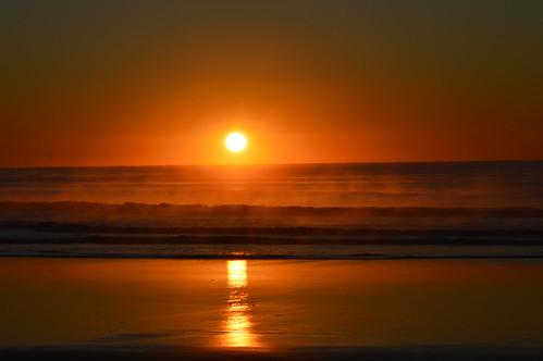 spencerpark beach sunrise sea sun mist misty waves nikon d3200 55300mm fog spray refletion sand canterbury newzealand