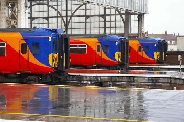 12-102  Three South West Trains Class 455s at a wet Waterloo