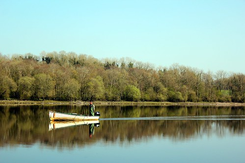 lake reflection water forest boat fisherman