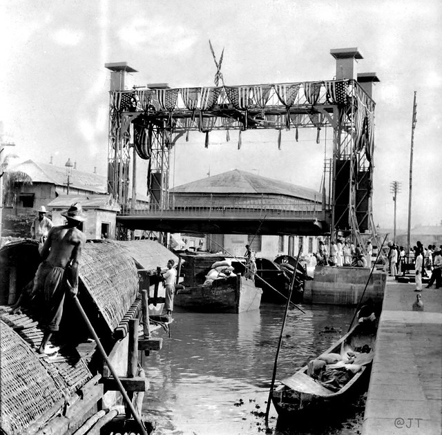 Freight boats at the automatic lift bridge, Binondo Canal, Manila, Philippines, early 20th Century