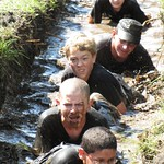 June 15, 2011 - 22:59 - Dallas County Iowa Sheriff Chad Leonard in the mud with the cadets from the Character Building Academy.  Cadets participate in a two week leadership program that is designed to challenge and educate young men and woman on subjects such as self respect, being a good citizen, volunteering in your community and interviewing techniques for gaining future employment.  Students are required to complete five challenges during the two weeks with the last challenge being a 6 mile mud run.
