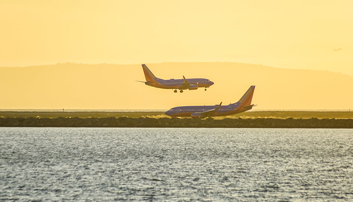 california sunset orange southwest color fall silhouette plane oakland airport oak twins nikon october pair bayarea eastbay boeing airlines alamedacounty sanleandro 737 2015 boury oaklandinternationalairport pbo31 d810 oysterbayregionalshoreline