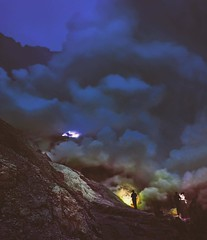 The fires of Ijen sulfur mine at 4 in the morning. If you're on the far east coast of Java Indonesia this a great 2am hike; you know, if you just can't sleep. The workers break sulfur from the crater in Mount Ijen next to gases that ignite into blue flame