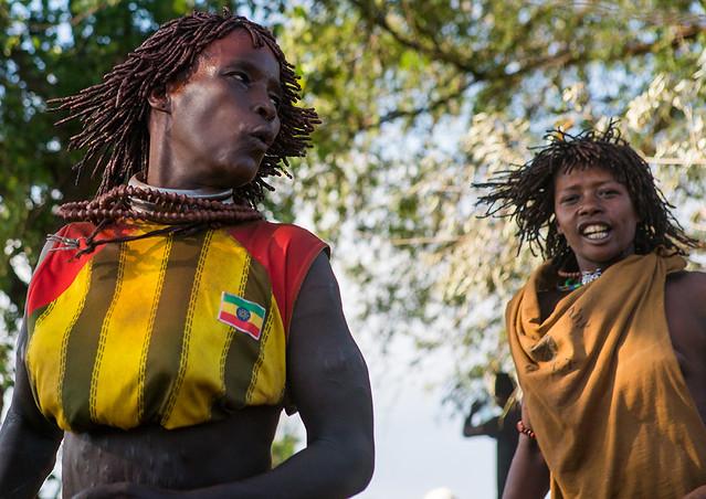 Hamer tribe women dancing during a bull jumping ceremony, Omo valley, Turmi, Ethiopia