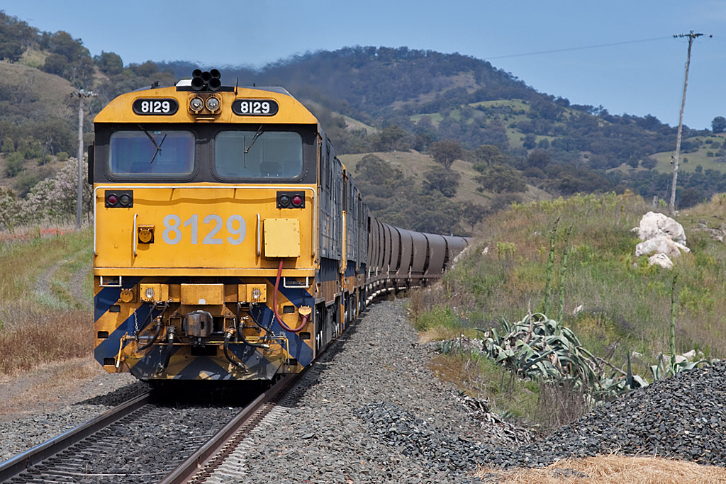 8129 banking a loaded coalie at Kankool by Peter Reading