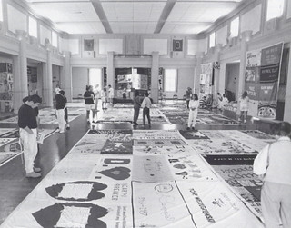 Viewing of the NAMES Project AIDS Memorial Quilt in Coop Ballroom on May 4-5, 1991. The Claremont Colleges community contributed to a fundraiser sponsored by the Student AIDS Awareness Committee