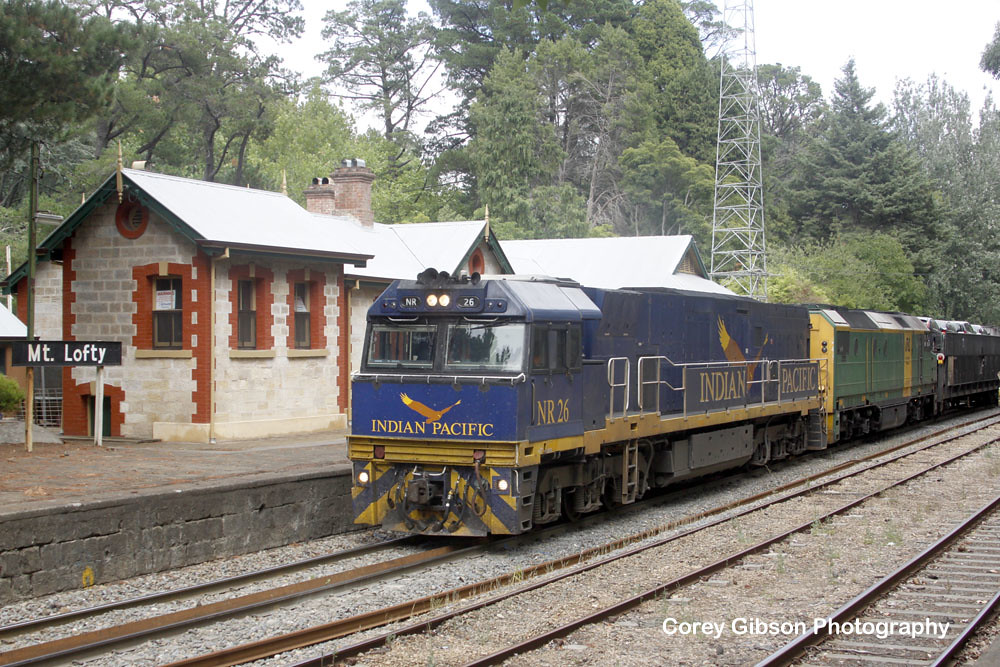 NR26 with a diverted Indian Pacific passes Mt Lofty Station by Corey Gibson