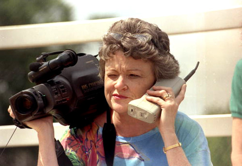 Journalist Lucy Morgan with video camera and phone | by State Library and Archives of Florida