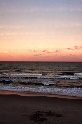 ocean sunset sky cloud sun water clouds nc waves wave northcarolina atlantic atlanticocean 28135mm canoneos50d pronouncedtopsl settingevening topailbeach