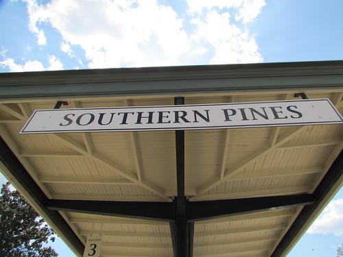 southernpinesrailwayrailroadstationsignncsky
