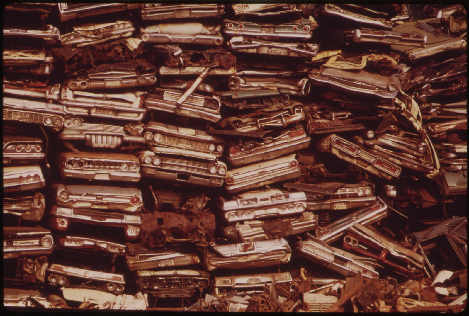 Stacked Cars In City Junkyard Will Be Used For Scrap, August 1973