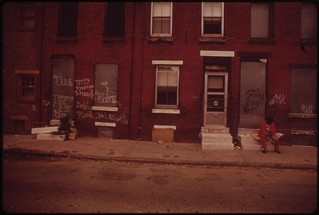 Two Men Sit Silently On Stoops Of Abandoned North Philadelphia Houses, August 1973