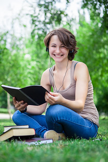 College student studying in Park | by CollegeDegrees360
