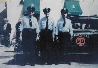 Police Officer Dick Green, Chief Reuben Wells, Officer Roy W. Wells (1943) | by ghs1922