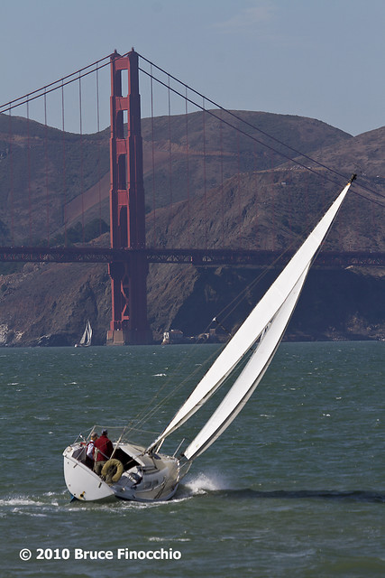 Sailboat Tacts In Front Of The North Tower Of The Golden Gate Bridge_BA79266