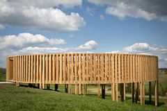 Aeneas Wilder (UK) builds an architectural structure in the landscape near the Monastery of Colen in Kerniel. The round construction with a magnificent 360º view is aligned with uniform vertical wooden slats. To enter the artwork is a special experience that refers to religion and reminds you of walking around a monastery. According to Aeneas Wilder, his work functions as a lens where the visitor can focus his thoughts and emotions with the landscape of Kerniel as a background.  Official opening: . May 4th, 2012  On display: . permanent from May 5th, 2012  Location: . Abbey Mariënlof (Monastery of Colen), Colenstraat 1, Kerniel (Borgloon)  www.z33.be/en/z-out/pit/aeneas-wilder-untitled-158  part of pit - art in the public space of Borgloon-Heers | Z33 - art in public space  photos: Kristof Vrancken / Z33