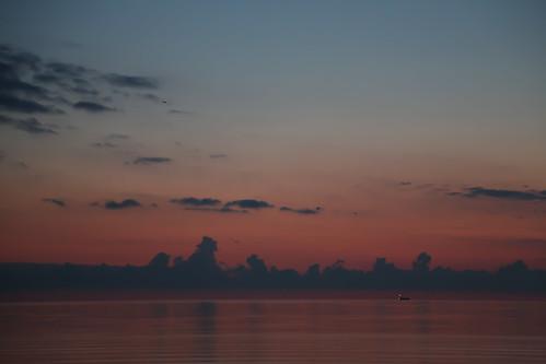 light newyork sunrise dawn fisherman greatlakes rochester lakeontario cloudscape pinkish secretsidewalk loneboat oldbeachavenue