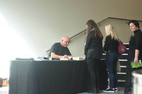 MIchael Grant at the signing desk