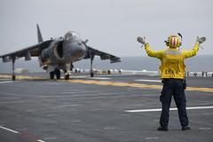 Aviation Boatswain's Mate (Handling) 2nd Class Brandon         Latimer directs an AV-8B Harrier in position for takeoff from the         ship's flight deck. (U.S. Navy/MC2 Jonathan A. Colon)