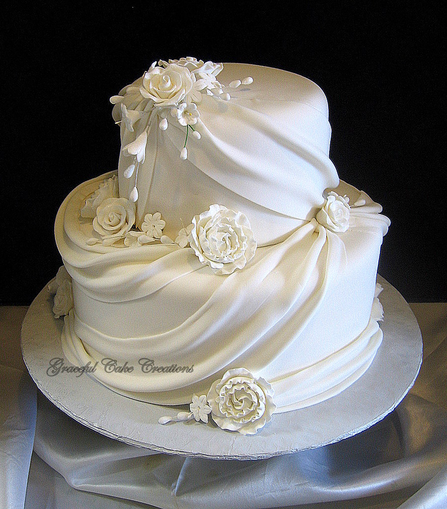 Elegant White Fondant Wedding Cake with Sugar Flowers and Swags