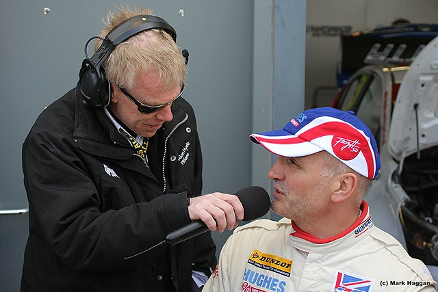 Tony Hughes being interviewed in the Pit Lane at the 2012 BTCC in Donington Park
