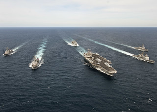 U.S. Navy ships maneuver into position while transiting the Atlantic Ocean. | by Official U.S. Navy Imagery