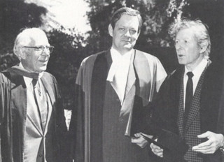 """Honorary degree recipients J. Edward """"Sandy"""" Sanders (left), former dean of admissions, financial aid and student affairs at Pomona College; and actor, comedian and humanitarian Danny Kaye flanked President David Alexander after commencement in 1978."""