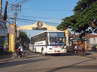 Photographed by John Ward on 11 July 2014. German Espiritu Liner Inc Hino TXG-106 (1337) at Archway Matungao St to Krus St at Bantayan St Triple Jct Matungao Bulacan Phils