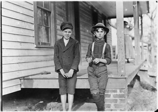 Springstein Mill. John Lewis (boy with hat), 12 years old, 1 year in mill, November 1908
