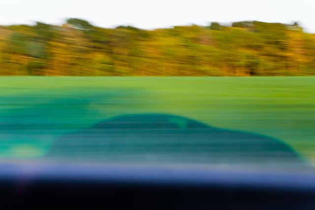 Shadow of Fast-moving Car on a Farm Field