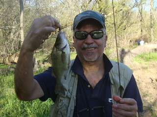 Photo of man holding a white perch