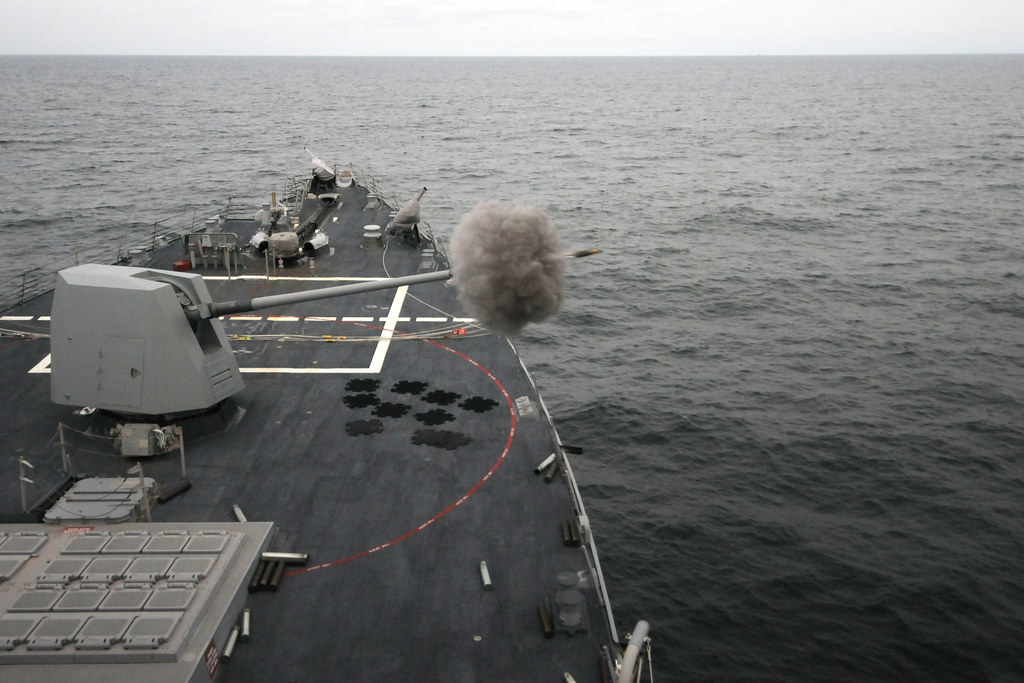 A high explosive control variable time round is fired from the MK 45 Mod 4 gun aboard USS Forrest Sherman.