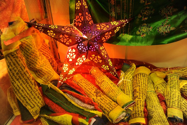 Light star, Tibetan Buddhist Prayer flags, wrapped up for sale, green silk formal khatag (kata), store in the Sears mall, Anchorage, Alaska, USA