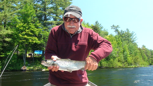 Mike with a fish and a smile | by Maine River Guides