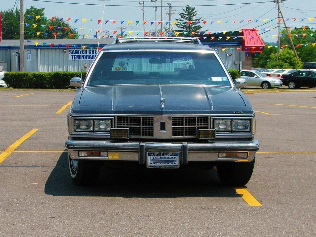 1986 86 OLDSMOBILE CUTLASS CUSTOM CRUISER Parking Sign