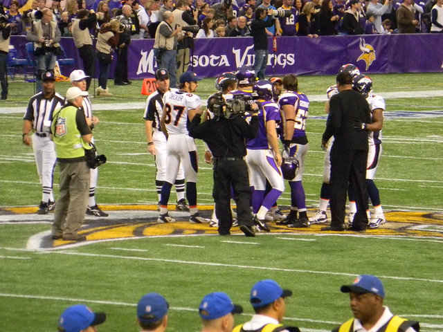 Eric Decker and the rest of the captains exchange hand shakes before the coin toss