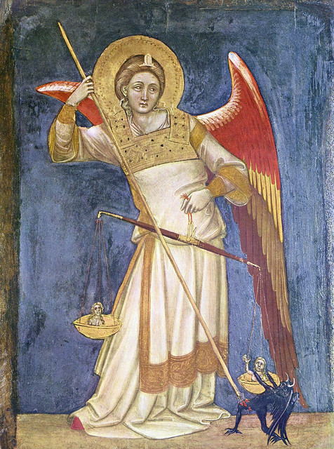 Archangel Michael weighing souls and defeating devil