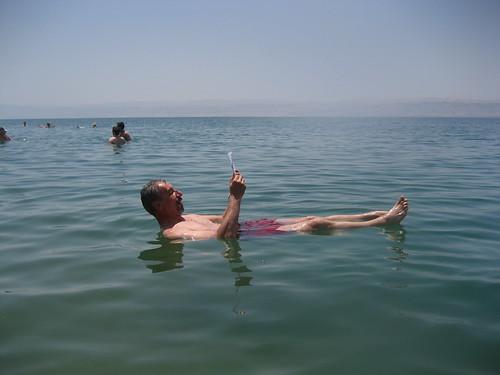 Dead Sea, man reading   by Arian Zwegers