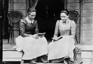 Two women reading on a verandah at Ingham, ca. 1894-1903 | by State Library of Queensland, Australia