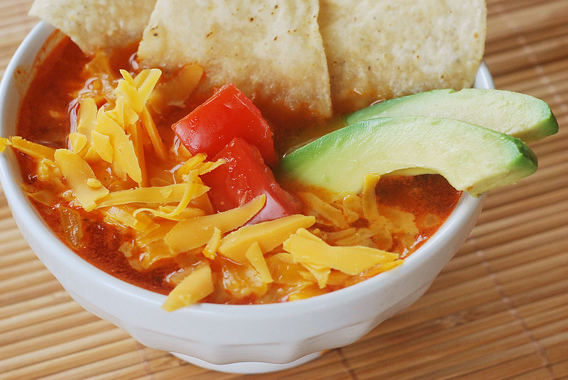 Texas Tortilla Soup - spicy chicken tortilla soup topped with cheddar cheese, avocado and tortilla chips. The most comforting soup for winter!