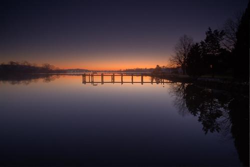 longexposure light reflection glass sunrise bench dawn mirror pier dock glow maryland newyear gradient cannon annapolis contemplation 1112 firstlight southriver 20secondexposure 5dmkii singhrayrgnd ef1740f40lusm