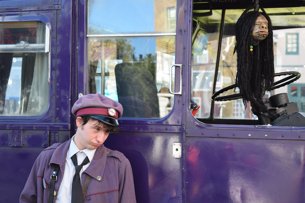 Stan Shunpike in front of the Knight Bus at The Wizarding