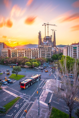 bus barcelona sagrada familia sacred family color sunset building car vehicle cathedral basilica apartment spain roof architecture minor roman catholic expiatory church holy christian christianity religion manmade antoni gaudi world heritage site golden hour magic clouds blur